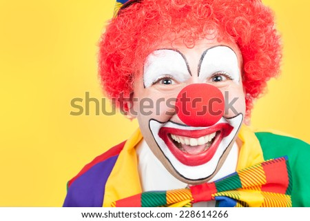 clown close on yellow background - stock photo