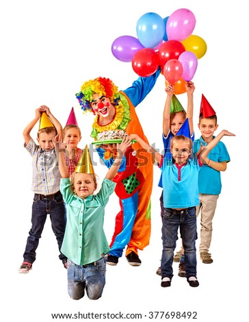 Clown keeps bunch of balloons and birthday cake with group children. Isolated. - stock photo