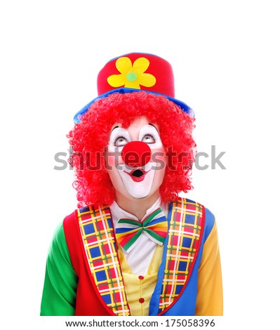 Clown looking to the copy space area - stock photo