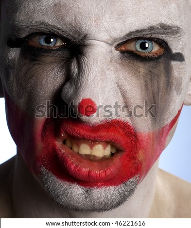 Clown looking very scary and angry in his crazy mood - stock photo