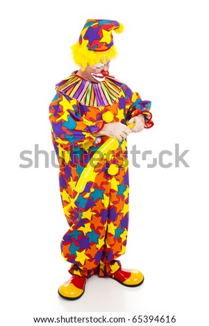 Clown twisting a balloon into the shape of an animal.  Full body isolated. - stock photo