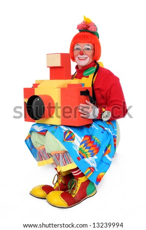 Clown with large toy camera over a white background - stock photo