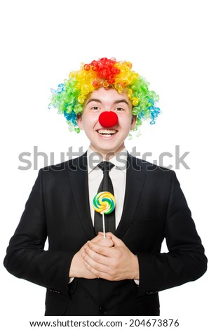 Clown with lollipop isolated on white - stock photo