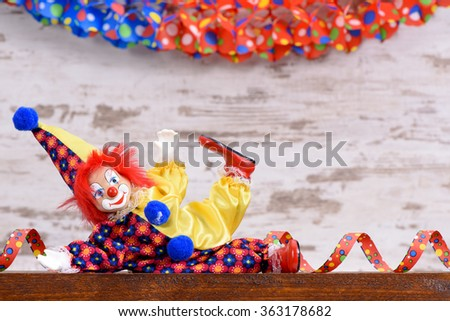 clown with paper streamer at carnival party