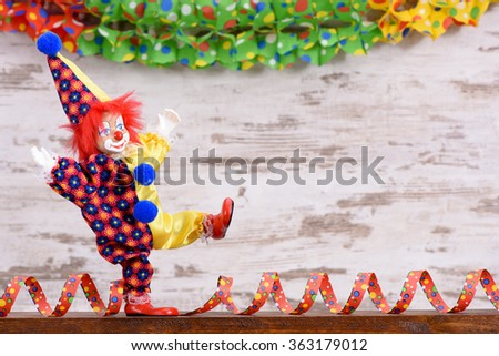 clown with paper streamer at carnival party - stock photo