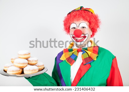 clown withe biscuits on tray on white - stock photo