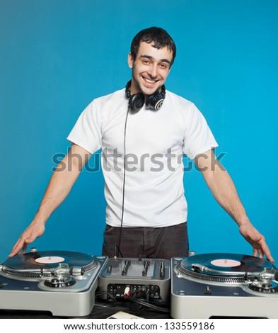 Club DJ  playing mixing music - stock photo
