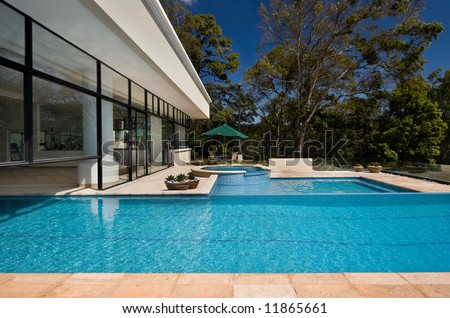 Club house with outdoor swimming pool - stock photo