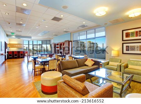 Club house with pool table and rest area. Residential building - stock photo