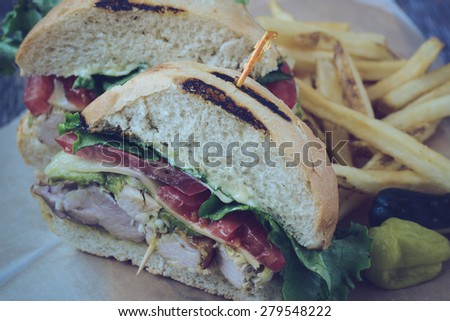 Club sandwich on rustic wood background