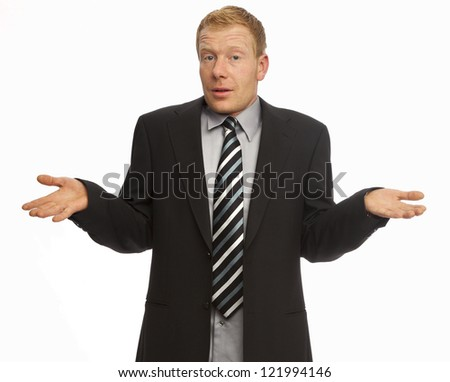 Clueless businessman posing against a white background - stock photo