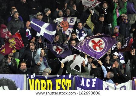 CLUJ NAPOCA - NOVEMBER 7: ACF FIORENTINA team fans supporting their team during a match in Europa League against CS Pandurii Targu Jiu, final score 2:1. On Nov. 7, 2013 in Cluj Napoca, Romania - stock photo