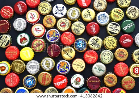 CLUJ-NAPOCA, ROMANIA - APRIL 29, 2016: Background of beer bottle caps, a mix of various European and Asian brands - stock photo