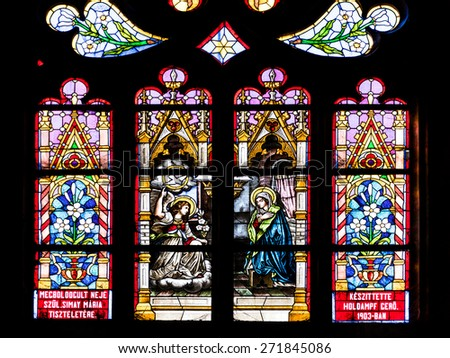CLUJ NAPOCA, ROMANIA - APRIL 14, 2015: Biblical Scene Stained Glass Window Inside The Gothic Roman Catholic Church of Saint Michael Built In 1390. - stock photo