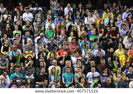CLUJ-NAPOCA, ROMANIA - APRIL 17, 2016: Crowd of people supporting their favorite player during a Fed Cup tennis match in the World Cup Play-Offs, Romania vs Germany