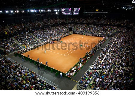 CLUJ-NAPOCA, ROMANIA - APRIL 17, 2016: Crowd of people supporting their favorites during a Fed Cup tennis match in the World Cup Play-Offs, Romania vs Germany - stock photo