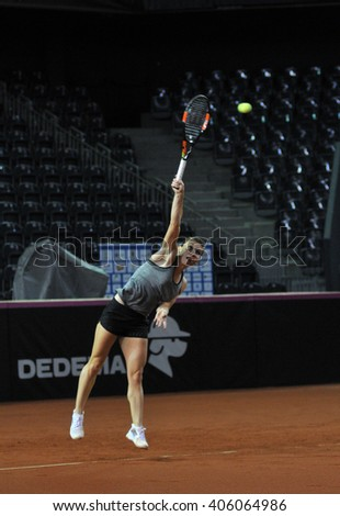 CLUJ-NAPOCA, ROMANIA - APRIL 15, 2016: Romanian tennis player Simona Halep (WTA ranking 6) plays during the training before the match against Germany