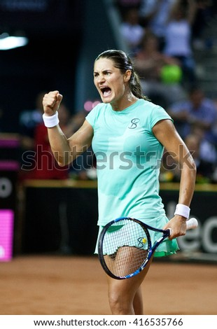 CLUJ-NAPOCA, ROMANIA - APRIL 17, 2016: Tennis player Monica Niculescu plays against Andrea Petkovic during a Fed Cup Play-Offs Tennis match, Romania vs Germany - stock photo