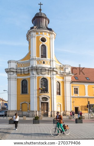 CLUJ NAPOCA, ROMANIA - APRIL 13, 2015: The Transfiguration Cathedral (Catedrala Schimbarea la Fata) also known as the Minorites Church was donated in 1924 by the Holy See to the Greek-Catholic Church. - stock photo