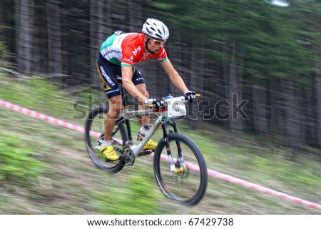 "CLUJ-NAPOCA, ROMANIA - APRIL 24: unknown Hungarian biker in action at ""Maros Bike Downhill Marathon 2010"" on APRIL 24, 2010 , CLUJ-NAPOCA, ROMANIA - stock photo"