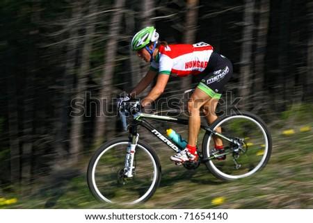 "CLUJ-NAPOCA, ROMANIA - APRIL 24: unknown Hungarian biker in action at ""Maros Bike Downhill Marathon 2010"" on APRIL 24, 2010 , Cluj-Napoca, Romania - stock photo"
