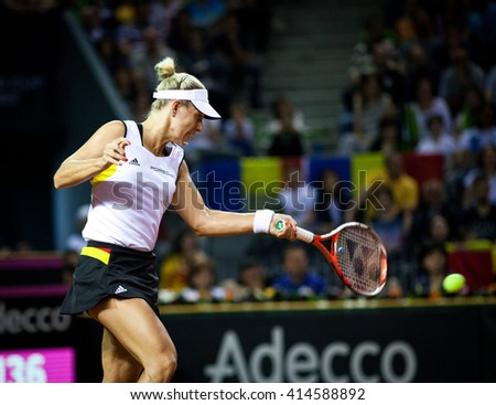 CLUJ-NAPOCA, ROMANIA - APRIL 16, 2016: Woman tennis player Angelique Kerber (WTA singles ranking 3) plays against Irina Begu during a Fed Cup match, play-offs between Romania and Germany