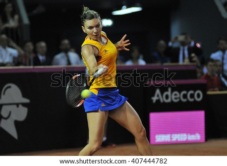 CLUJ-NAPOCA, ROMANIA - APRIL 16, 2016: WTA 6 ranked woman tennis player Simona Halep plays against Andrea Petkovic during a Fed Cup Play-Offs Tennis match, Romania vs Germany
