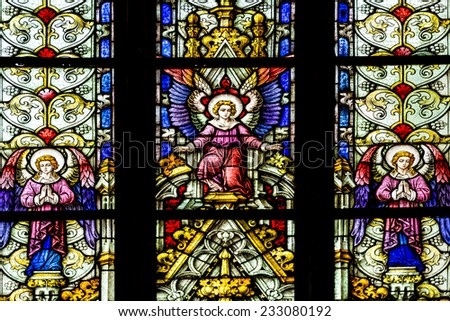 CLUJ NAPOCA, ROMANIA - AUGUST 21, 2014: Angels In Heaven Stained Glass Window Inside The Gothic Roman Catholic Church of Saint Michael Built In 1390. - stock photo