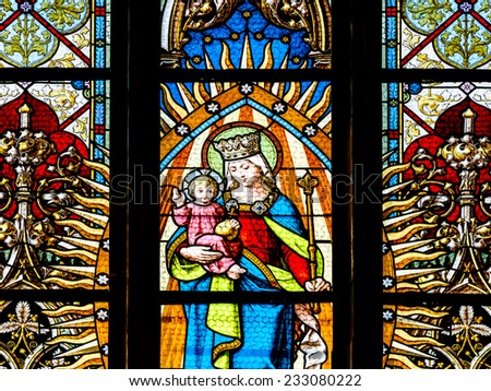 CLUJ NAPOCA, ROMANIA - AUGUST 21, 2014: Baby Jesus And Virgin Mary Stained Glass Window Inside The Gothic Roman Catholic Church of Saint Michael Built In 1390. - stock photo