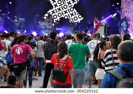 CLUJ NAPOCA, ROMANIA - AUGUST 2, 2015: Crowd of cheerful people having fun during an Irish Maffia concert at Untold Festival  - stock photo