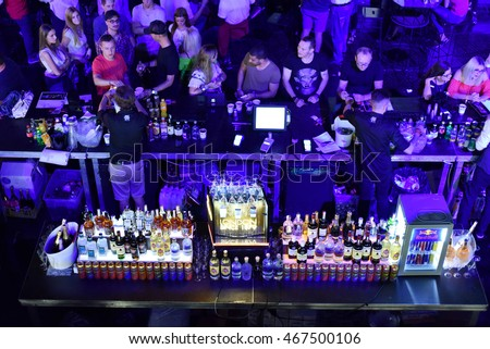 CLUJ-NAPOCA, ROMANIA - AUGUST 4, 2016: Crowd of people attending Fratelli Social Events bar and buying drinks during the Untold Festival. Fratelli is one of the most elite bars in Romania