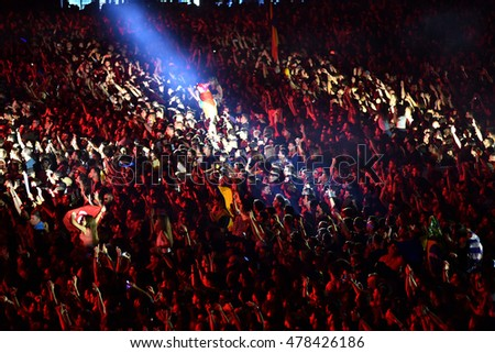 CLUJ NAPOCA, ROMANIA - JULY 8, 2016: Crowd having fun with raising hands at a Lost Frequencies live concert at Untold Festival, the Best Major Music Festival of Europe