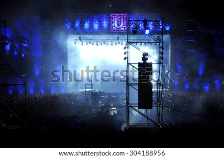 CLUJ NAPOCA, ROMANIA - JULY 30, 2015: Party people having fun during a Dimitri Vegas and Like Mike live concert at the Untold Festival in the European Youth Capital city of Cluj Napoca - stock photo