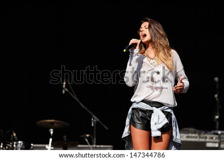 CLUJ NAPOCA, ROMANIA - JUNE 8: The famous romanian singer Antonia performs on stage during the Cluj Arena Music Fest 2013, on June 8, 2013 in Cluj Napoca, Romania. - stock photo