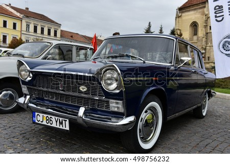 CLUJ-NAPOCA, ROMANIA - OCTOBER 15, 2016: Italian car FIAT and other vintage cars exhibited during the Retro Mobile Autumn Parade in the city of Cluj Napoca. Event organized by Retro Mobil Club Romania