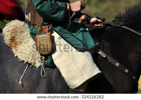 CLUJ-NAPOCA, ROMANIA - OCTOBER 3: Members of Eagles of Calata Nomadic group performing a free equestrian demonstration with Hunnic and archaic Hungarian costumes. On October 3, 2015 in Cluj, Romania - stock photo
