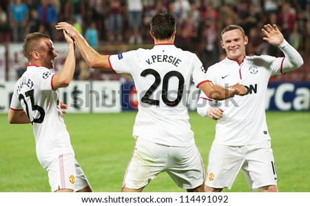 CLUJ-NAPOCA, ROMANIA - OCTOBER 2: van Persie, Cleverley and Rooney in UEFA Champions League match, CFR 1907 Cluj vs Manchester United, Dr. C. Radulescu Stadium on 2 Oct., 2012 in Cluj-Napoca, Romania - stock photo