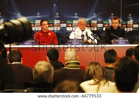 CLUJ, ROMANIA - DECEMBER 7: The official staff of AS Roma, with Claudio Ranieri looks on during a press conference before UEFA CL game against CFR 1907 Cluj on December 7, 2010 in Cluj-Napoca, Romania