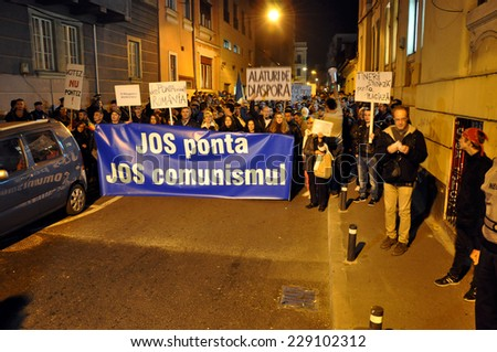 CLUJ, ROMANIA - NOVEMBER 8: Romanians protest against Victor Ponta because Romanians abroad were stopped from voting by the Socialist Government. On Nov 8, 2014 in Cluj, Romania - stock photo