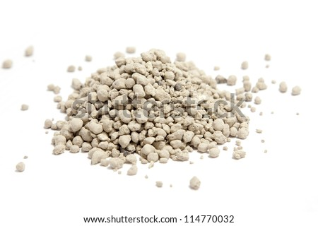 clumping clay cat litter isolated on white - stock photo
