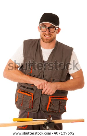 Clumsy carpenter punches finger while hammering nail with hammer isolated over white. - stock photo