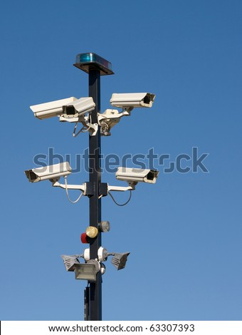 Cluster of security cameras at entrance to secure area. - stock photo