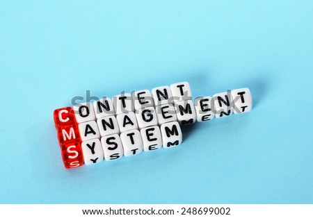 CMS Content Management System  definition  acronym on blue - stock photo