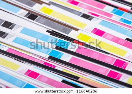 CMYK color on printed sheets of paper after cutting - stock photo