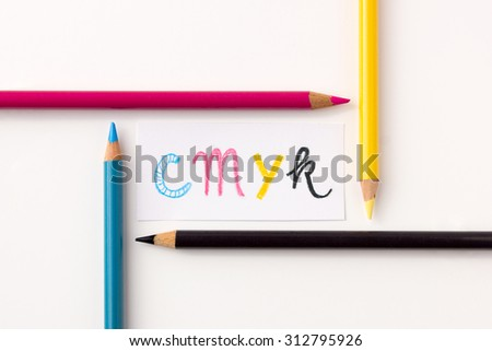 CMYK concept with colored pencils - stock photo