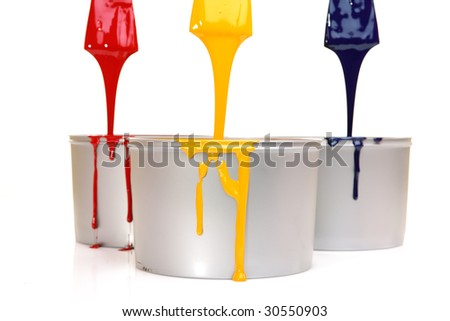 CMYK trowels, with printing ink - stock photo