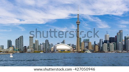 CN tower in Toronto skyline seen from Lake Ontario. The city offers boat tours which are very popular with tourists and visitors to the Financial Capital of Canada
