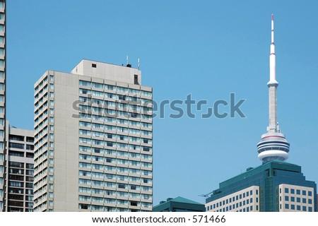 CN Tower through some codominiums - stock photo