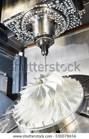 cnc metal working machining center with cutter tool during metal detail milling at factory. Authentic shooting in challenging conditions. - stock photo