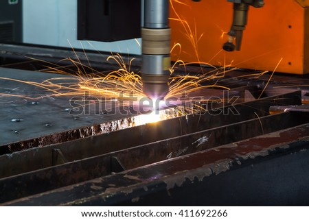 CNC plasma cutting in action (in motion) to cut the steel plate